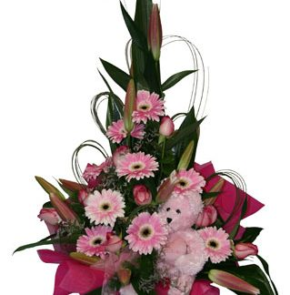 new baby girl gift flower arrangement
